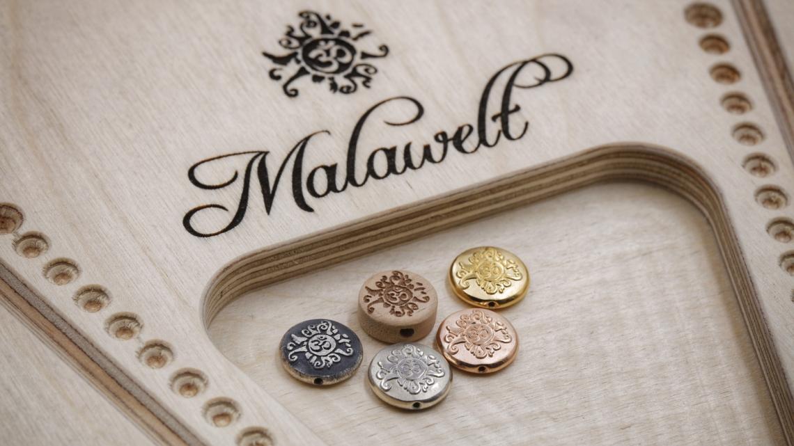 Malamünze Malasonne als Guruperle, Element für Armband
